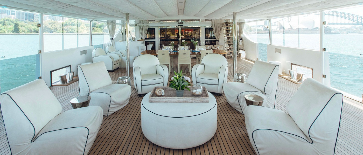 Plush lounge seating on Luxury boat hire on Tango