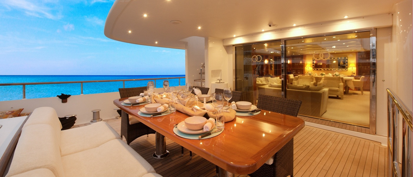 Outdoor dining on Beluga luxury boat hire