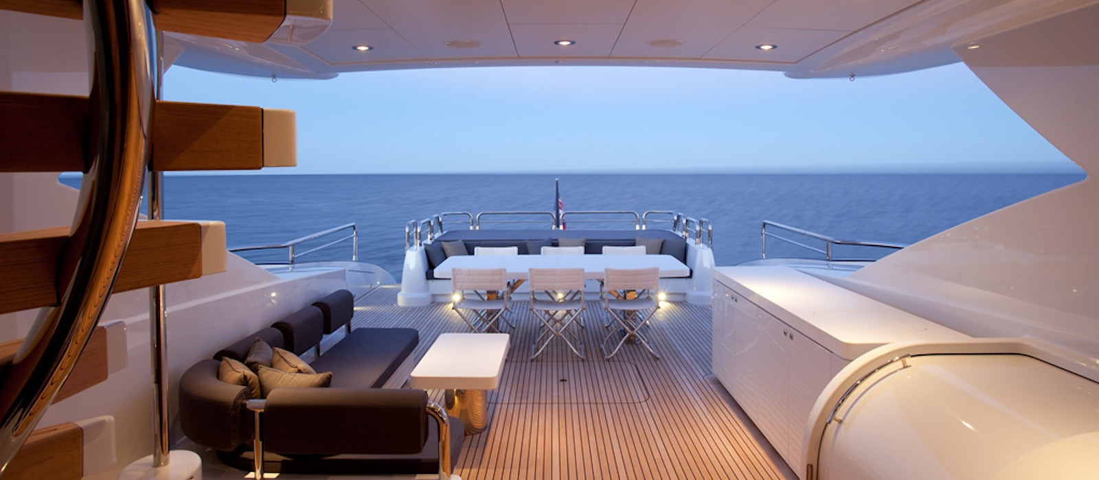 Looking out onto aft deck of Quantum luxury boat hire